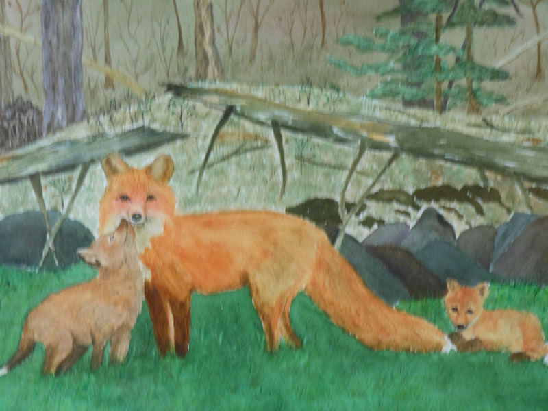 Red fox and kits by Yvette Fleming
